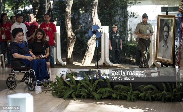 Former Philippine first lady and now congresswoman Imelda Marcos with her daughter Imee Marcos visit the tomb of former Philippine president and late...