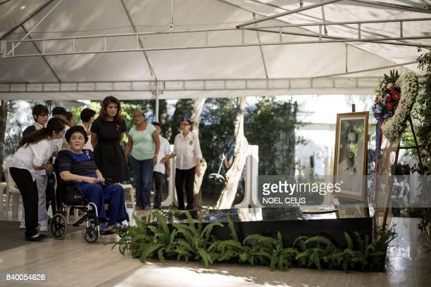 Former Philippine first lady and now congresswoman Imelda Marcos with her daughter Imee Marcos visit the tomb of former president and late dictator...