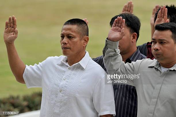 Former Philippine Marine colonel Ariel Querubin and 135 other former military rebels take their oath of allegiance to the Philippine constitution at...