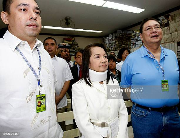 Former Philippine President and now Congresswoman Gloria Macapagal Arroyo is flanked by her husband Jose Miguel Arroyo and her son Diosdado Dato...