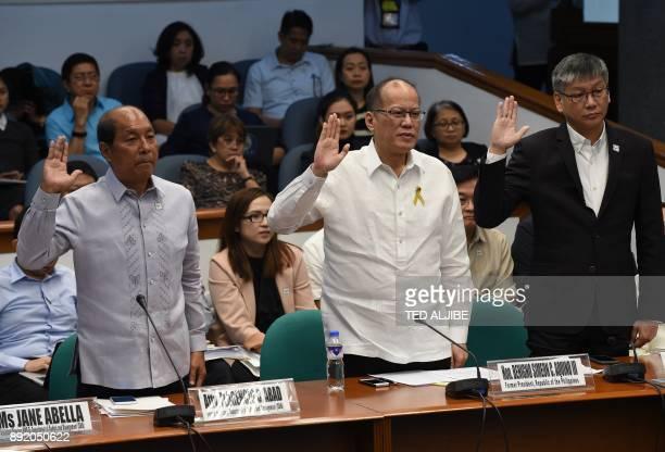 Former Philippine president Benigno Aquino former budget secretary Florencio Abad and former executive secretary Paquito Ochoa take an oath during...