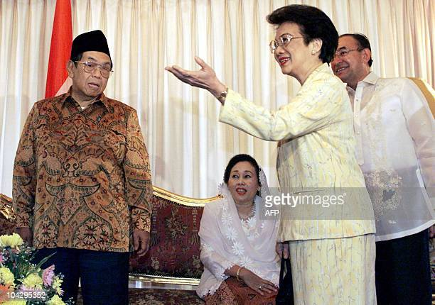 Former Philippine president Corazon Aquino gestures during her courtesy call with Indonesian President Abdurrahman Wahid and First Lady Sinta Nuriyah...