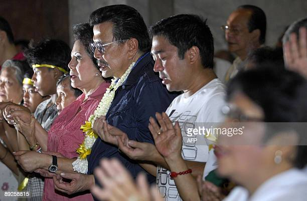 Former Philippine president Joseph Estrada and his wife former senator Luisa Estrada attend a special 'healing mass' in Manila on July 26 2009 for...