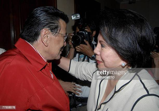 Former Philippine president Joseph Estrada is hugged by his wife former senator Luisa Ejercito at their residence in San Juan suburban Manila after...
