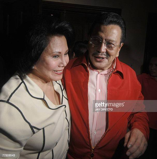 Former Philippine president Joseph Estrada is seen with his wife former senator Luisa Ejercito at their residence in San Juan suburban Manila after...