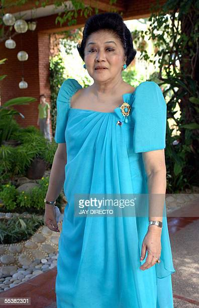 Former Philippines first lady Imelda Marcos takes a walk at a resort during a visit to her late husband's home province .in Laoag nothern...