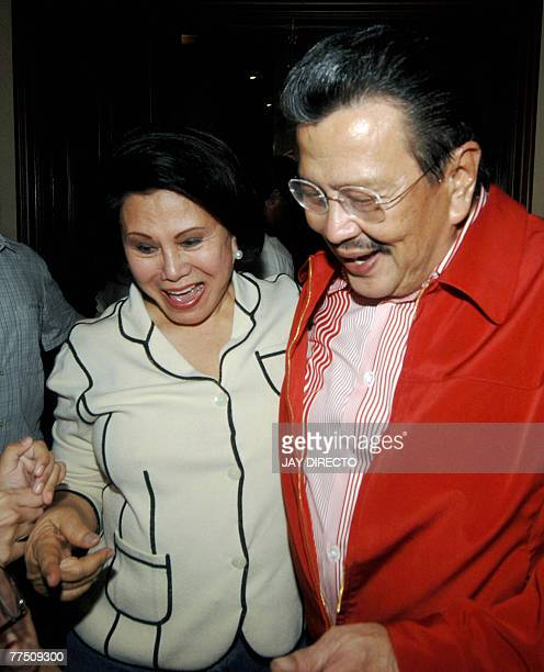 Former Philippines president Joseph Estrada is hugs his wife former senator Luisa Ejercito at their residence in the San Juan suburb of Manila after...