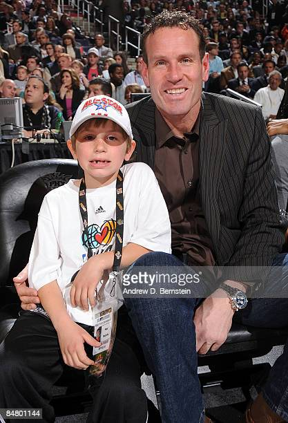 Former Phoenix Suns player Dan Majerle sits with son Max Majerle during Foot Locker ThreePoint Shootout on AllStar Saturday Night part of 2009 NBA...