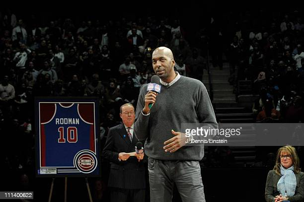 Former Pistons teammate John Salley speaks to Dennis Rodman during the retirement ceremony of his Detroit Pistons on April 1 2011 at The Palace of...