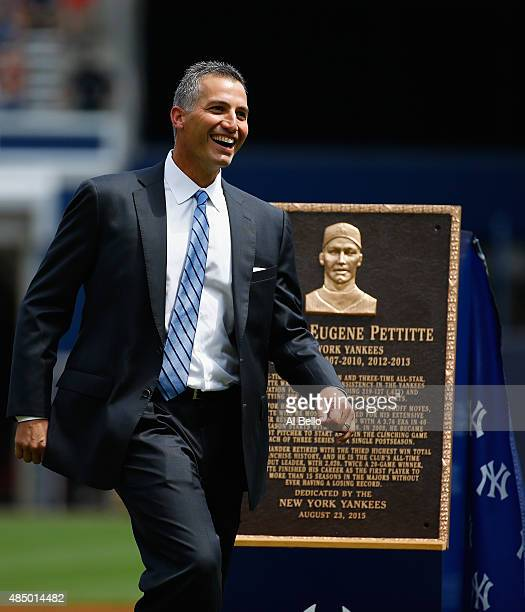 Former pitcher Andy Pettitte of the New York Yankees stands next to his retired plaque which will go into Monument Park before the game against the...