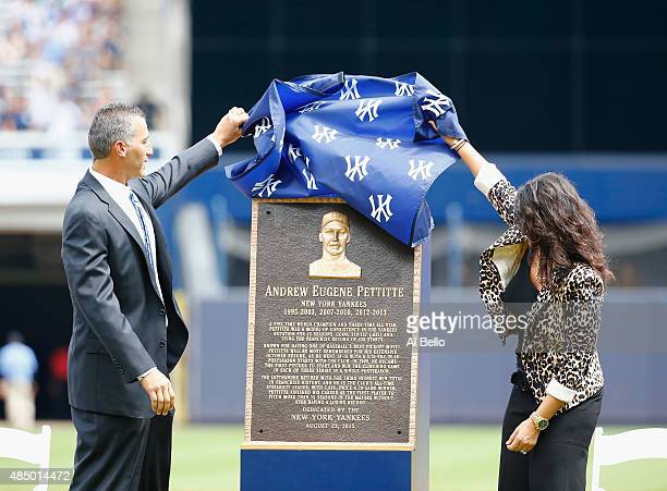 Former pitcher Andy Pettitte of the New York Yankees unveils his retired plaque which will go into Monument Park before the game against the...