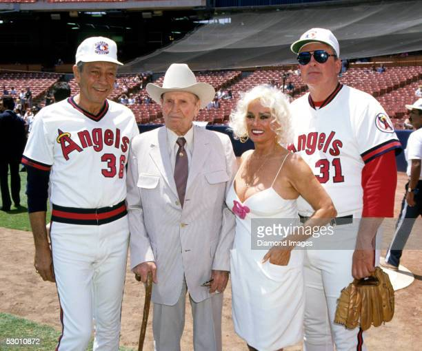 Former pitcher Bo Belinsky California Angels owner Gene Autry Actress Mamie Van Doren and former pitcher Dean Chance pose for a portrait prior to an...