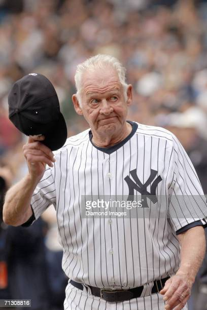 Former pitcher Don Larsen of the New York Yankees tips his cap to the crowd after being introduced during Old Timers Day ceremonies on June 24 2006...