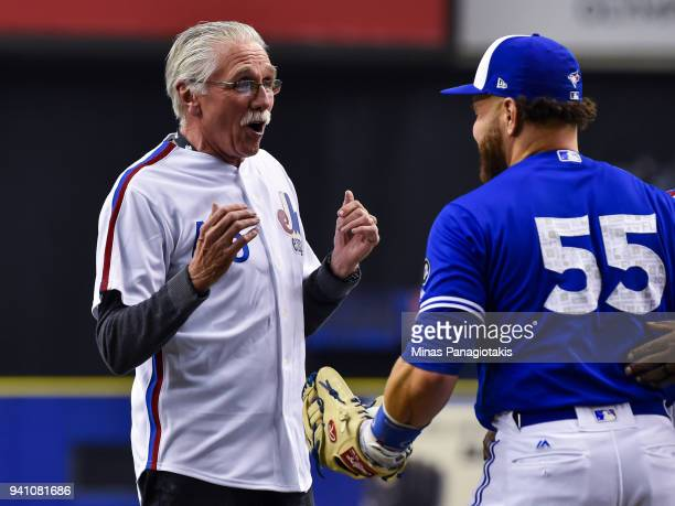 Former pitcher for the Montreal Expos Steve Rogers reacts to seeing Russell Martin of the Toronto Blue Jays during the pregame ceremony between the...