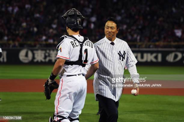 Former pitcher Hiroki Kuroda shakes hands with Pitcher Kenta Maeda of the Los Angeles DodDeesignated hitter JT Realmuto of the Miami Marlins after...