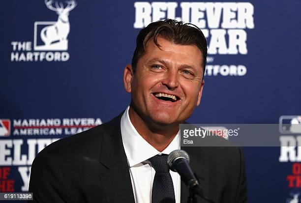 Former pitcher Trevor Hoffman laughs during a ceremony naming the 2016 winners of the Mariano Rivera American League Reliever of the Year Award and...