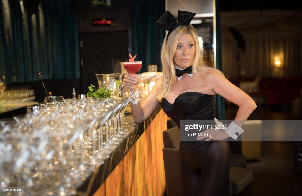 Former Playboy Bunny Angie Best poses for photos with playboy bunnies ahead of her return as the iconic Bunny Mother exclusively at the Telling Tales event at Playboy Club London on September 21, 2017 in London, England.