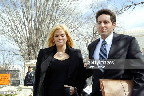 Former Playboy Playmate Anna Nicole Smith and her attorney Howard Stern leave the US Supreme Court in Washington, DC Tuesday afternoon after there...