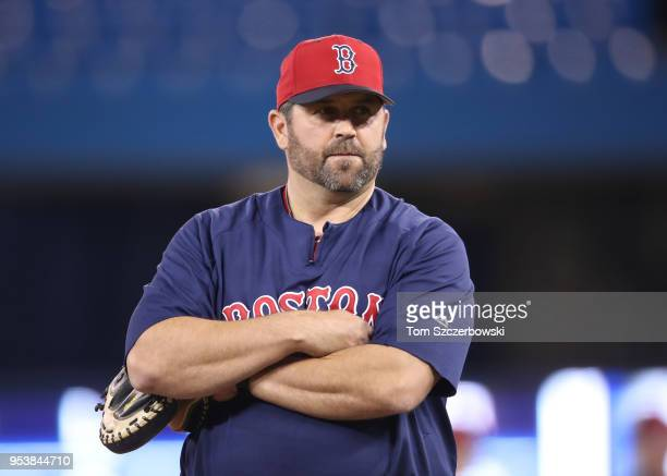 Former player and coach Jason Varitek of the Boston Red Sox during batting practice before MLB game action against the Toronto Blue Jays at Rogers...