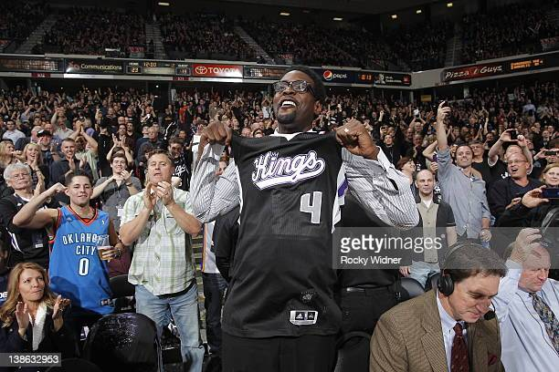 Former player and five time NBA AllStar Chris Webber hold up a jersey to the crowd during a break in action as the Sacramento Kings take on the...