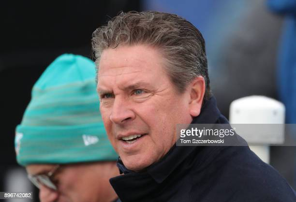 Former player and Hall of Fame member Dan Marino of the Miami Dolphins looks on before the start of NFL game action against the Buffalo Bills at New...