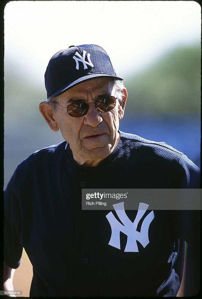 Former player and manager Yogi Berra of the New York Yankees stands on the field in 2002.