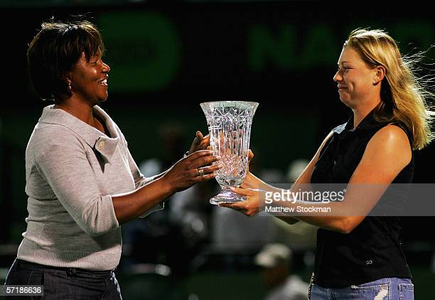 Former player and mentor Lori McNeil receives the Mentor Appreciation Award from tennis player Vera Zvonareva on stadium court during the Nasdaq100...