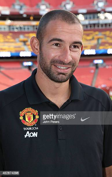 Former player and now MUTV pundit Danny Higginbotham of Manchester United watches from the stand during an open training session as part of their...