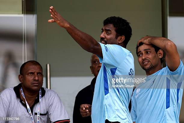 Former player Aravinda de Silva Muttiah Muralidaran and Tillekeratne Dilshan of Sri Lanka outside the dressing rooms at training at Wankhede Stadium...