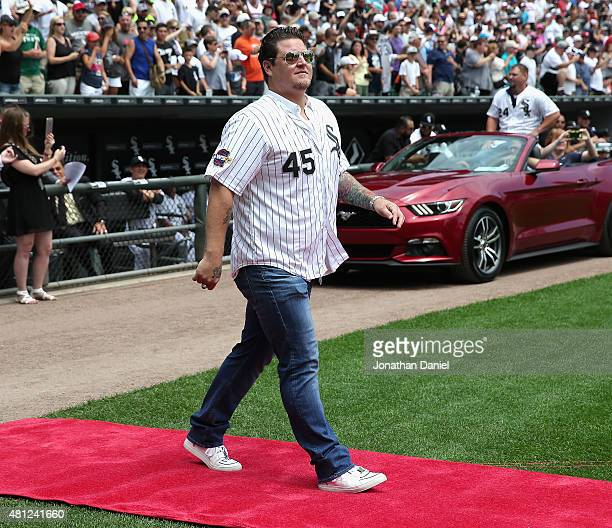 Former player Bobby Jenks of the Chicago White Sox is introduced to the crowd during a ceremony honoring the 10th anniversary of the 2005 World...