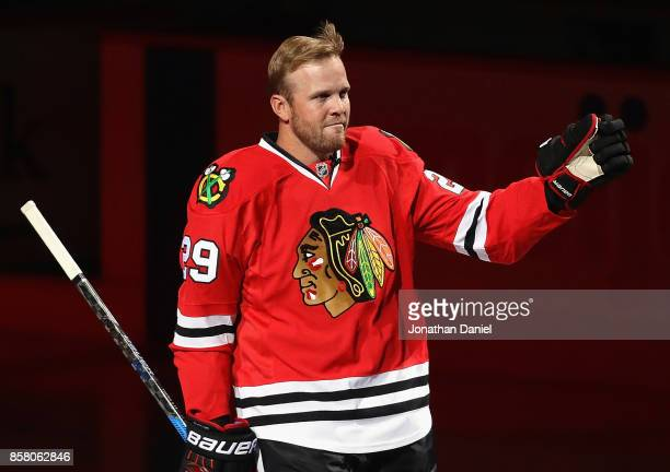 Former player Brian Bickell of the Chicago Blackhawks who signed a one day contract to retire as a member of the Blackhawks sheds a tear as he waves...