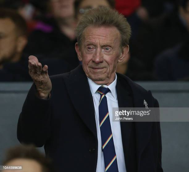 Former player Denis Law waits in the director's box ahead of the UEFA Champions League between Manchester United and Valencia at Old Trafford on...