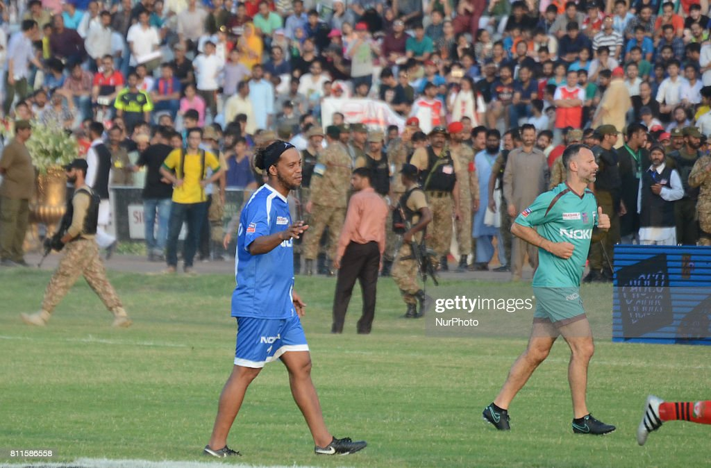 Former player for FC Barcelona Brazilian Ronaldinho english player Ryan Giggs play with pakistan football player during friendly matchJuly 9 2017 in..