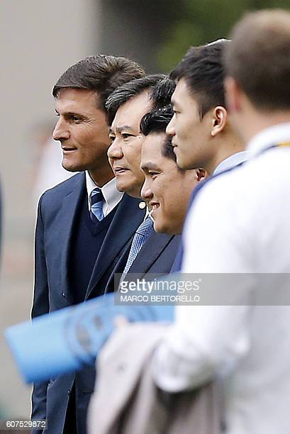 Former player Javier Zanetti chairman of Suning Group Zhang Jindong and Inter Milan's chairman Erick Thohir poses before the Italian Serie A football...