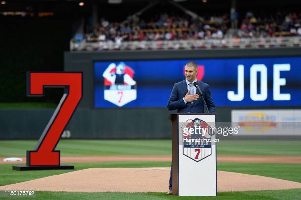 Former player Joe Mauer speaks as the Minnesota Twins retire his number before the game between the Minnesota Twins and the Kansas City Royals on...