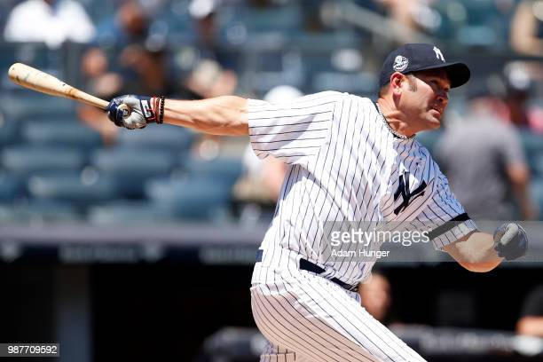 Former player Johnny Damon of the New York Yankees in action during the New York Yankees 72nd Old Timers Day game before the Yankees play against the...