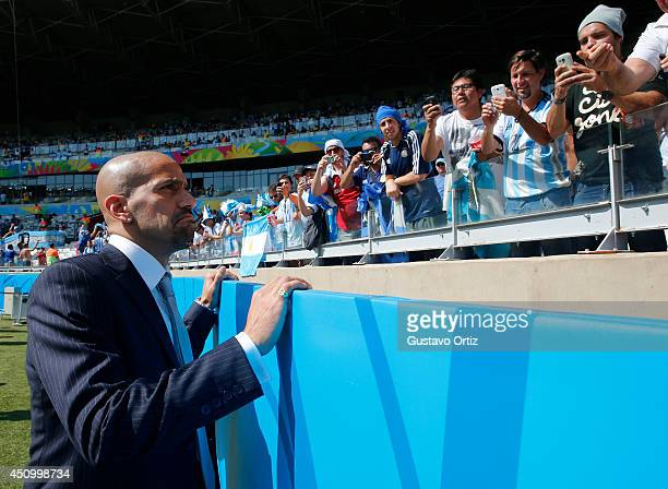 Former player Juan Sebastian Veron walks in the field during the 2014 FIFA World Cup Brazil Group F match between Argentina and Iran at Estadio...