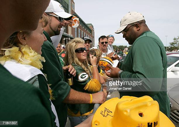 Former player Keith Jackson of the Green Bay Packers signs autographs in the parking lot before the Packers take on the Chicago Bears on September 10...