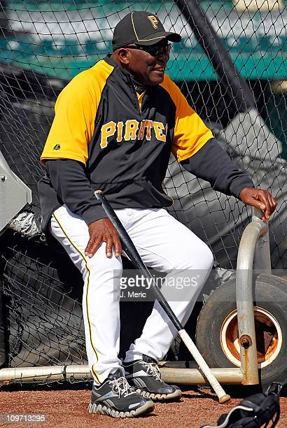 Former player Manny Sanguillen of the Pittsburgh Pirates sits on the batting cage just before the start of the Grapefruit League Spring Training Game...