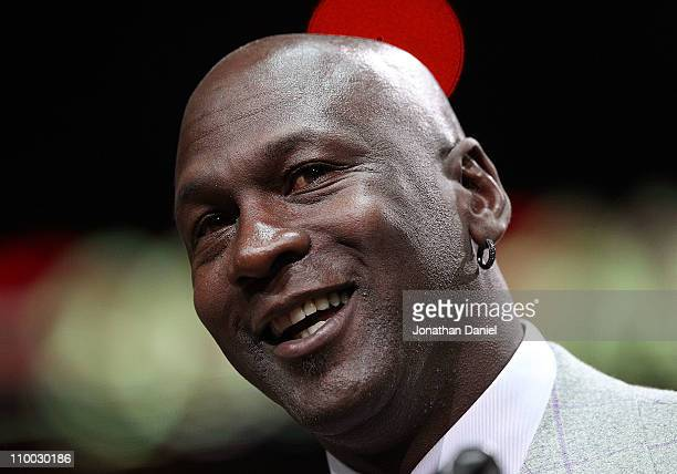 Former player Michael Jordan of the Chicago Bulls addresses the crowd during a 20th anniversary recognition ceremony of the Bulls 1st NBA...