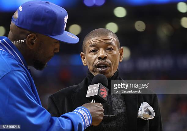 Former player Muggsy Bogues is interviewed by the arena announcer during a break in the action of the Toronto Raptors NBA game against the New York...