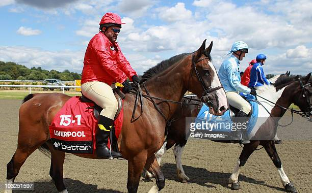 Former player Neil Ruddock's horse struggles with the weight ahead of the Betfair Five Horse Race at Kempton Park racecourse on August 5 2010 in...
