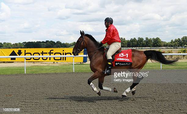 Former player Neil Ruddock's horse struggles with the weight during the Betfair Five Horse Race at Kempton Park racecourse on August 5 2010 in...