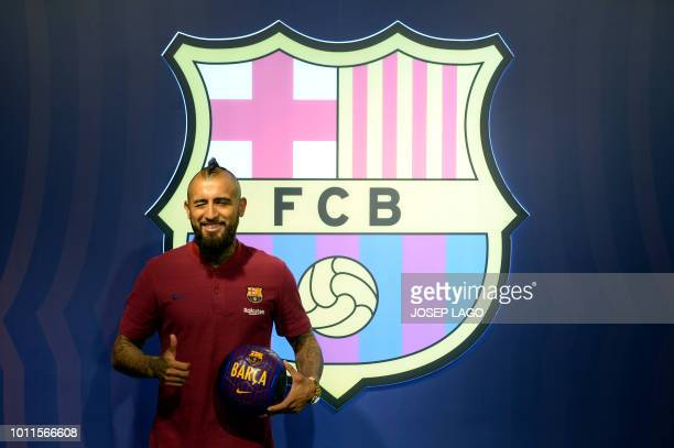 TOPSHOT Former player of Bayern Munich football club Arturo Vidal thumbs up as he poses at his new team's headquarters on August 5 one day after FC...