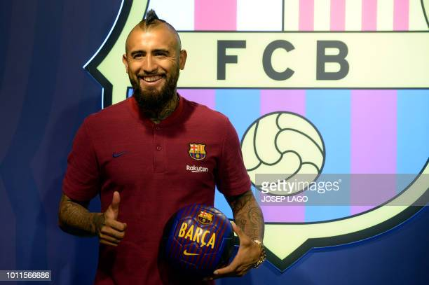 Former player of Bayern Munich football club Arturo Vidal thumbs up as he poses at his new team's headquarters on August 5 one day after FC Barcelona...