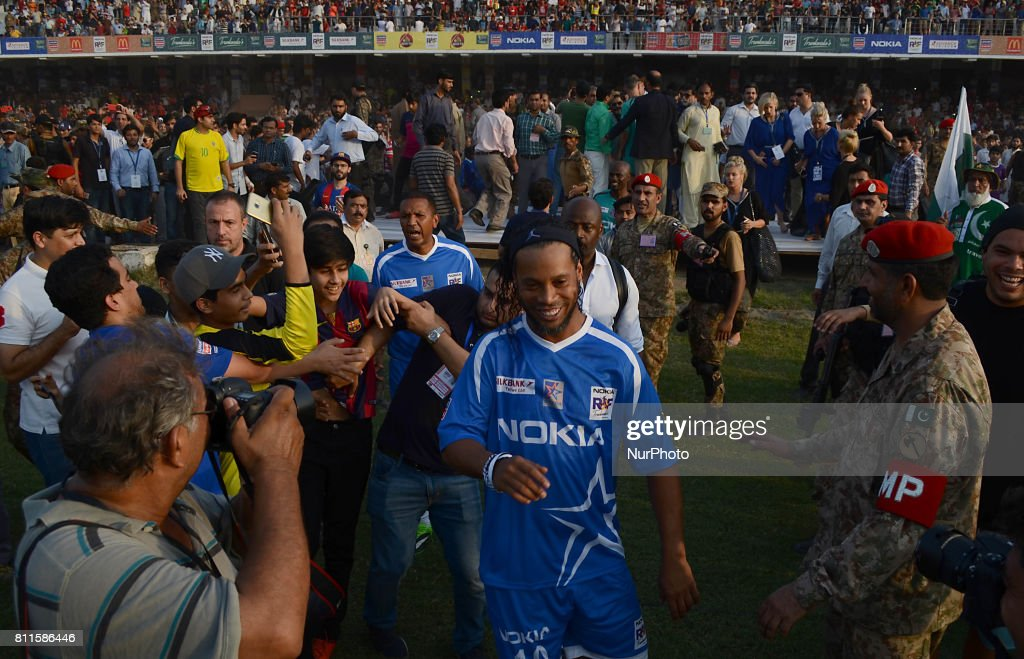 Former player of FC Barcelona Brazilian Ronaldinho arrives for friendly match with Pakistani football players on July 9 2017 in Lahore Eight of...