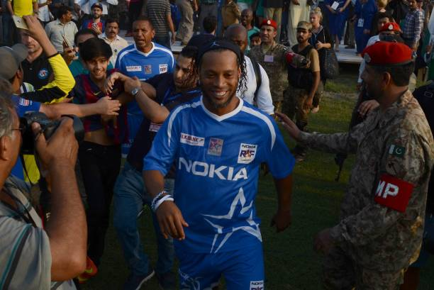 Former player of FC Barcelona Ronaldinho arrives for friendly match with Pakistani football players in Lahore Pakistan on July 9 2017 Eight of...