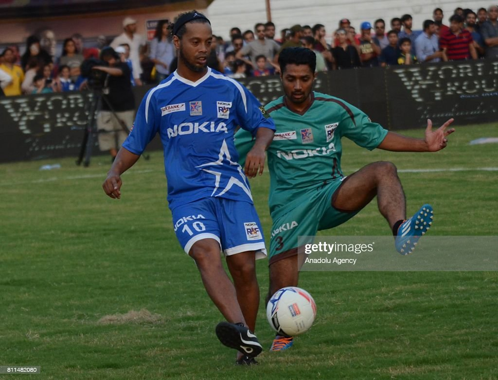 Former player of FC Barcelona Ronaldinho in action during friendly match with Pakistani football players in Lahore Pakistan on July 9 2017 Eight of...