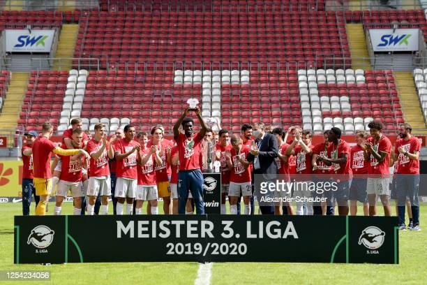 Former player of FC Bayern Muenchen II Kwasi Okyere Wriedt of FC Bayern Muenchen II lifts the trophy to celebrate the championship following the 3....