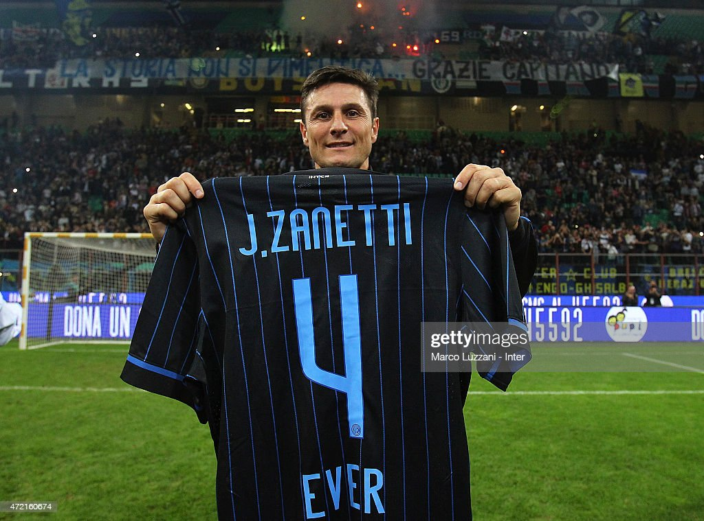 Former player of Fc Internazionale Javier Zanetti (L) is honored by having his #4 jersey retired during the game the Zanetti and friends Match for Expo 2015 at Stadio Giuseppe Meazza on May 4, 2015 in Milan, Italy.